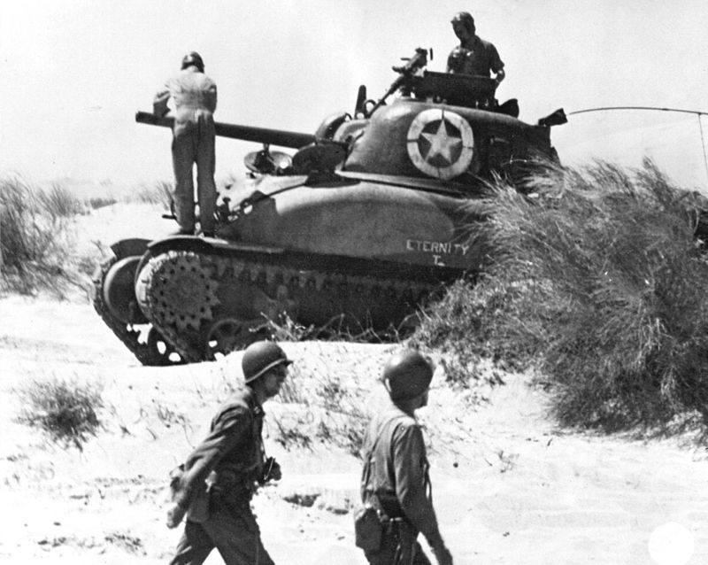 The first Sherman in U.S. service, the M4A1, appeared in the North Africa Campaign. Here one of the 7th Army lands at Red Beach 2 on July 10, 1943 during the Allied invasion of Sicily