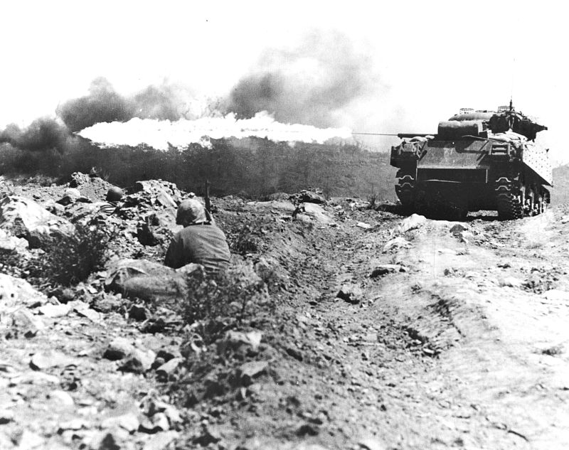 A USMC M4A3 uses its flame thrower during the Battle of Iwo Jima