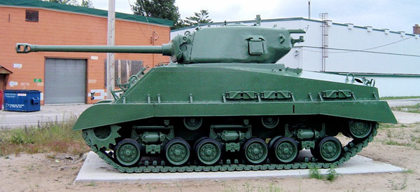 M4A2(76) HVSS with T23 turret and later 76 mm gun's muzzle brake; it also sports fenders, usually omitted on U.S. vehicles to ease maintenance